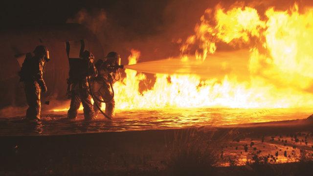 Firefighters battling a fire.