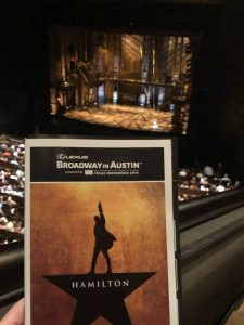 Picture of the Hamilton playbill in front of of our view of the stage.